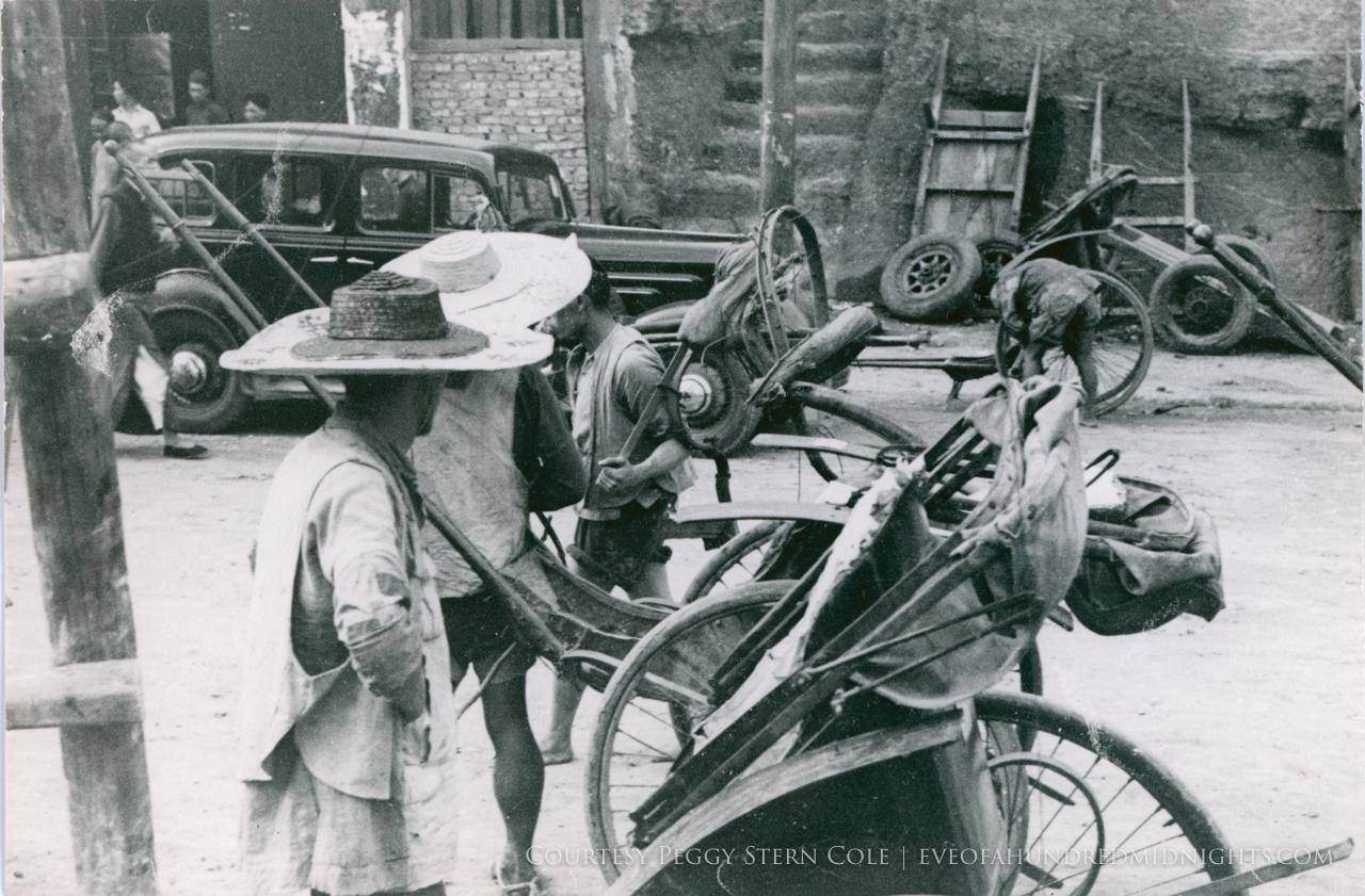Rickshaws being worked on in Chungking.jpg