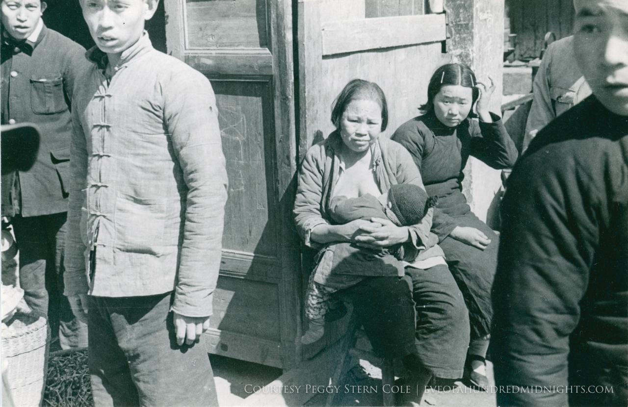 Woman looking at camera while breastfeeding.jpg