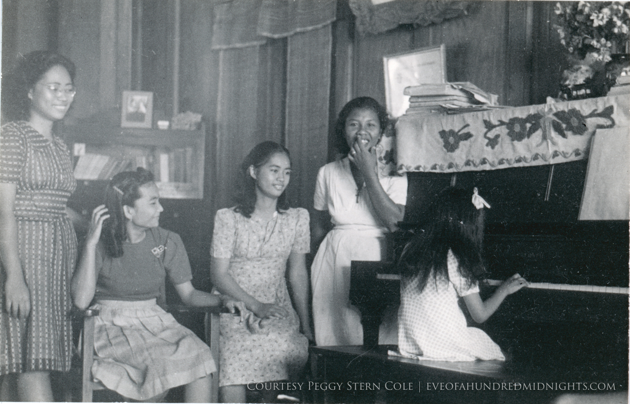 Girls around piano in Philippines.jpg