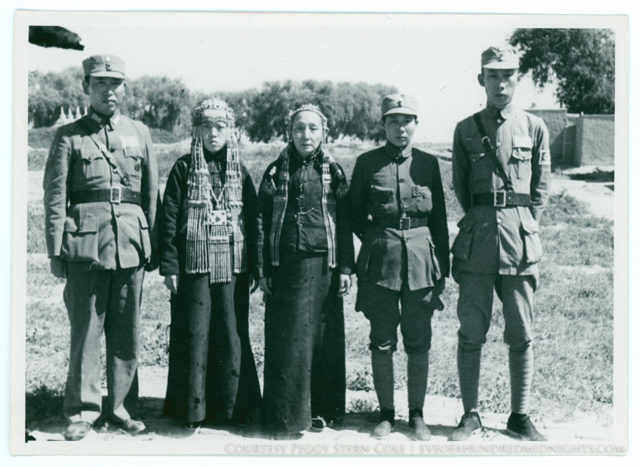 Soldiers with traditional women with 175 marking on back - front.jpg