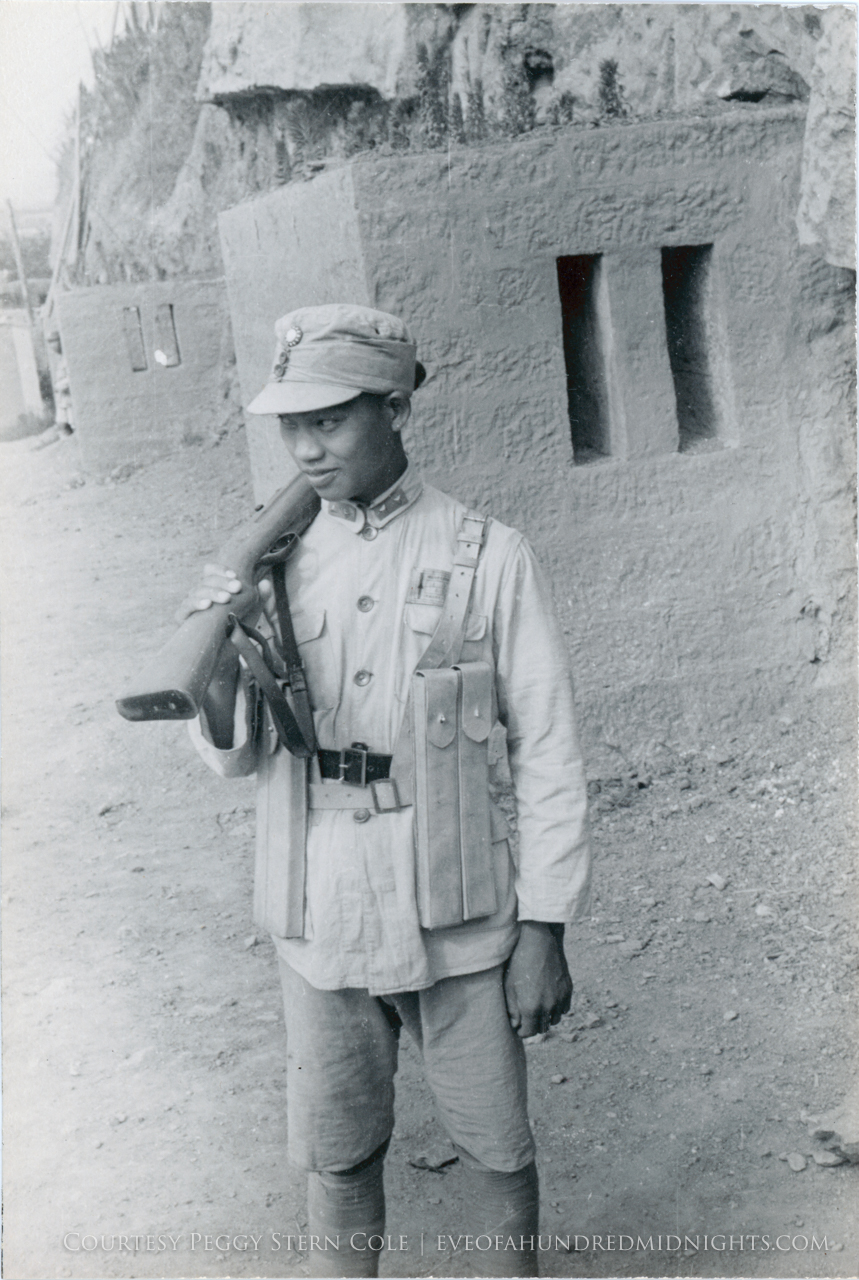 Soldier carrying rifle on shoulder.jpg