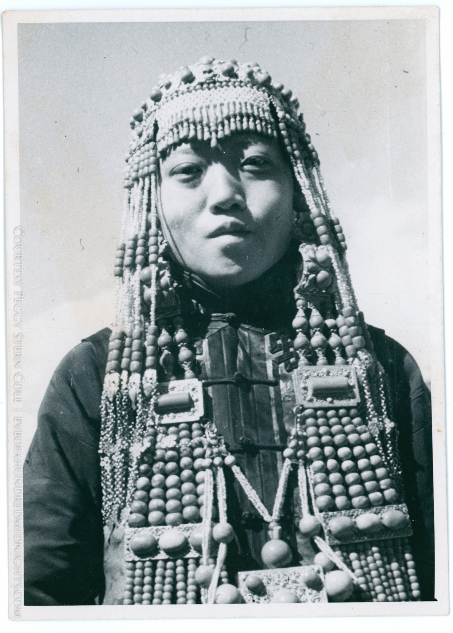 Woman in headdress with 157 marking on back - front.jpg