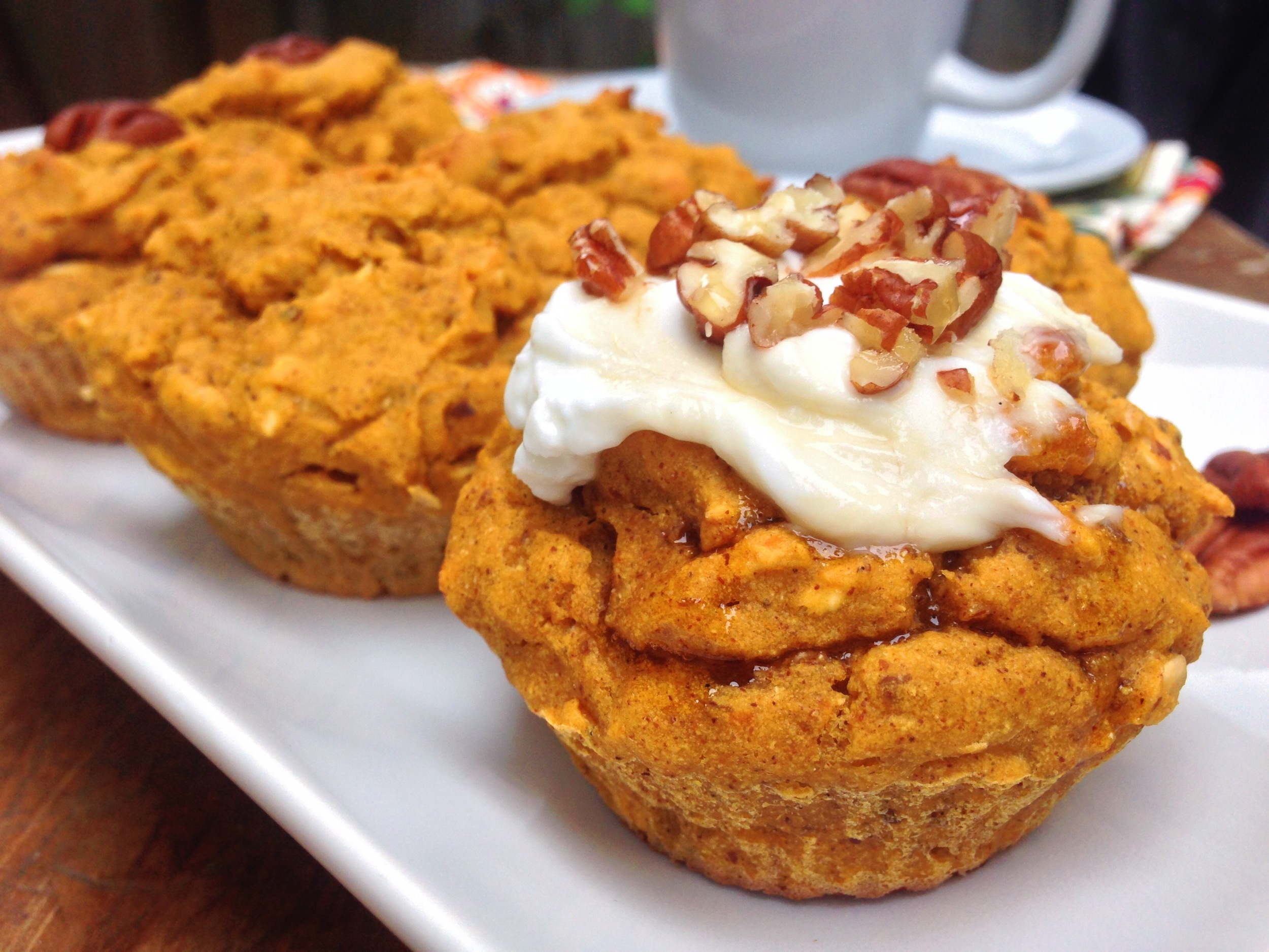 Pumpkin Apple Muffins            2 eggs, room temp        1/2 cup cooked pumpkin puree or canned organic pumpkin        1/3 cup raw honey        1/4 cup unrefined organic coconut oil        1 tsp vanilla        2 1/2 cups, loose not packed almond flour        1/2 tsp baking soda        1/4 tsp sea salt        1/1/2 tsp cinnamon        1/2 tsp nutmeg        1/4 tsp cloves        1/4 tsp ginger      1 chopped, peeled granny smith apple      Preheat the oven to 350'.    Mix the dry ingredients together.    Whip the eggs and add vanilla. Mix in the pumpkin until evenly distributed.    Add the wet ingredients to the dry and mix for 1 minute on medium speed. Add the apples and mix for another 30 seconds.    Prepare your tins with either cupcake liners or grease muffin tin with coconut oil and a light dusting of almond flour. Fill the liners above the 3/4 line and stick in the oven for up to 20 minutes or until brown on the outside and a toothpick comes out clean. This makes approx 12 muffins.    Enjoy your breakfast!