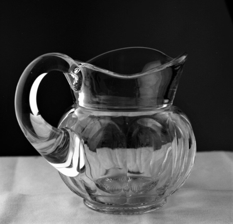 Glass pitcher. More similar in  STILL LIFE