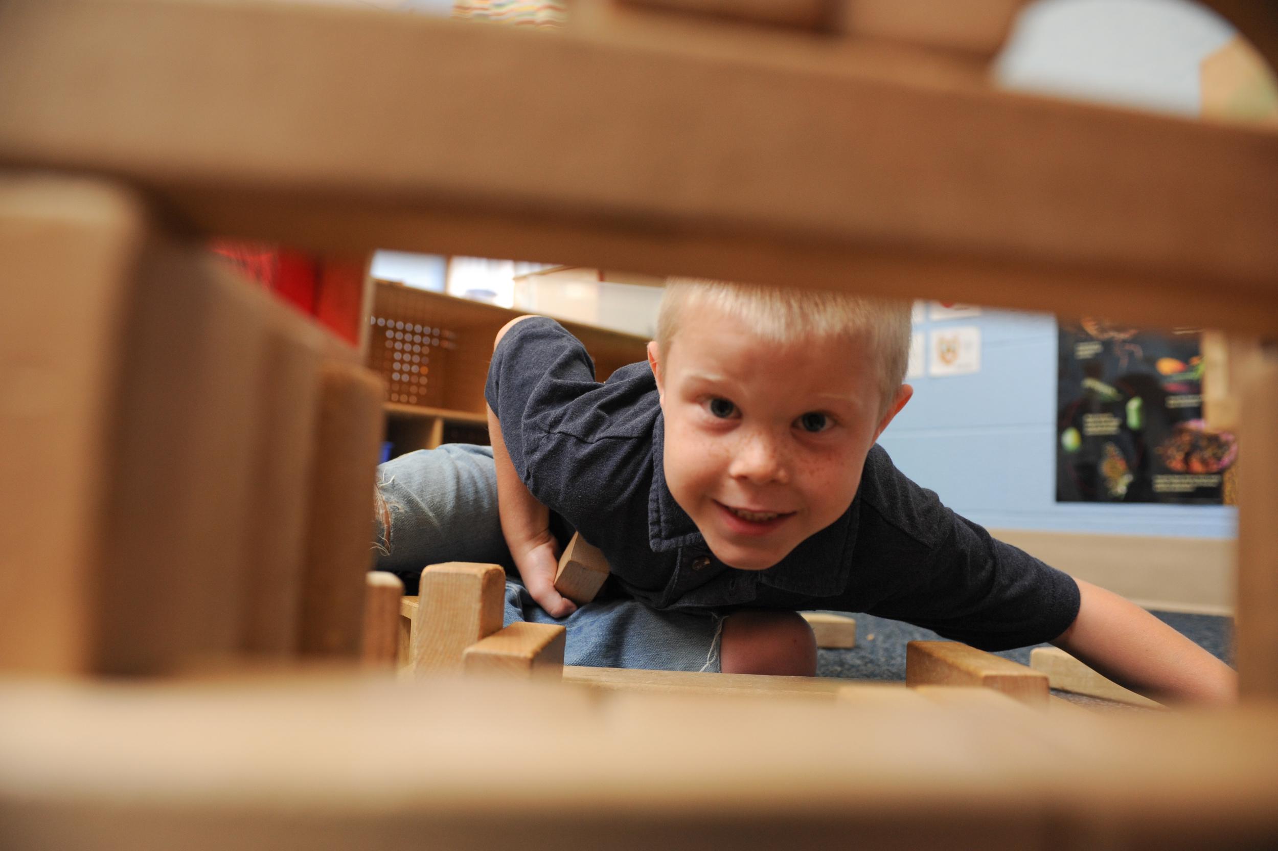 boy looking through blocks.jpg