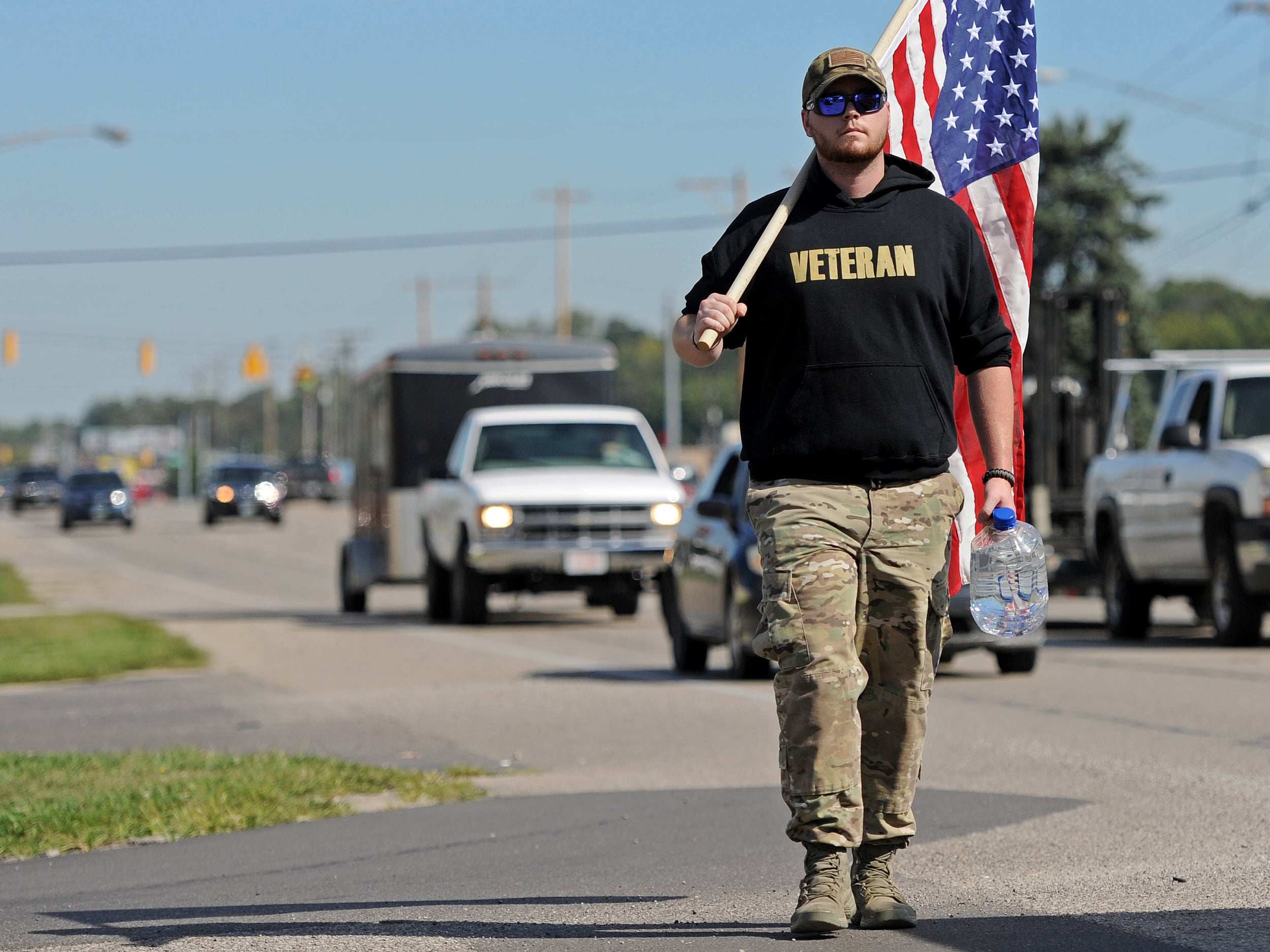 Air Force veteran Isaac Gray walked up and down Bridge Street on Friday to serve as a visual reminder that today is the anniversary of the Sept. 11 attack that happened 14 years ago today.