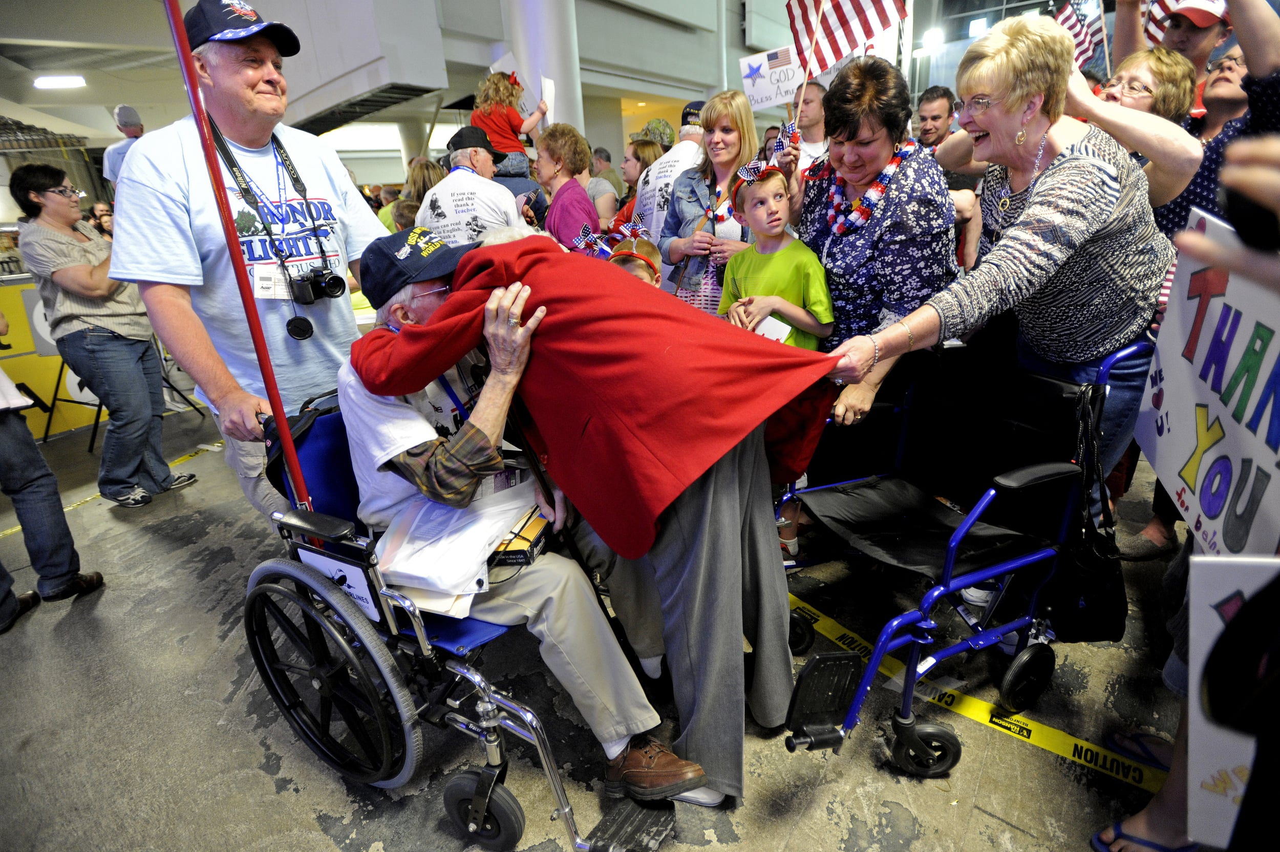 An eager wife pulled herself out of her wheelchair and into her husbands arms in a heartwarming embrace after the Honor Flight returned to Columbus. The veterans disembarked from the plane at Columbus International Airport close to 9:30 p.m. after getting to the airport before 5:30 a.m. in the morning to begin their adventure to the biggest surprise of the day- between 400 and 600 of their closest family and friends waiting to give them a hero's welcome home.