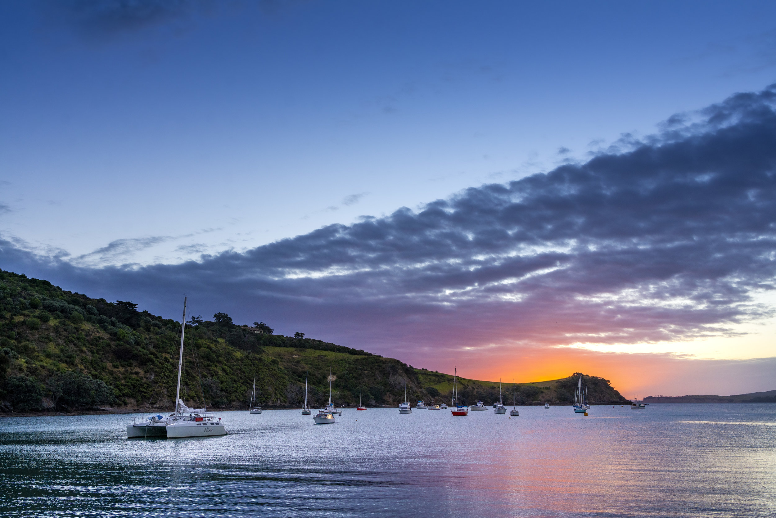 Waiheke Island is painted in an array of colors as the sun begins to set on the island. (Elise Marie Photography)