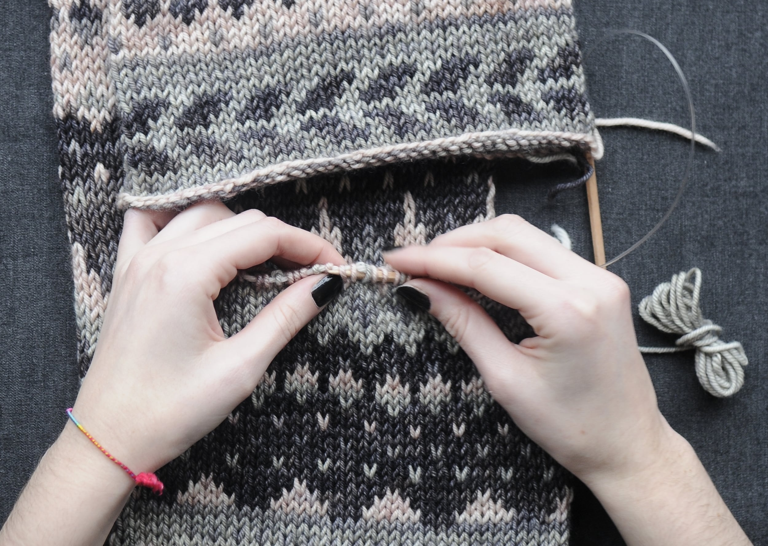 1: Start by placing your live stitches back onto a circular needle and remove waste yarn.