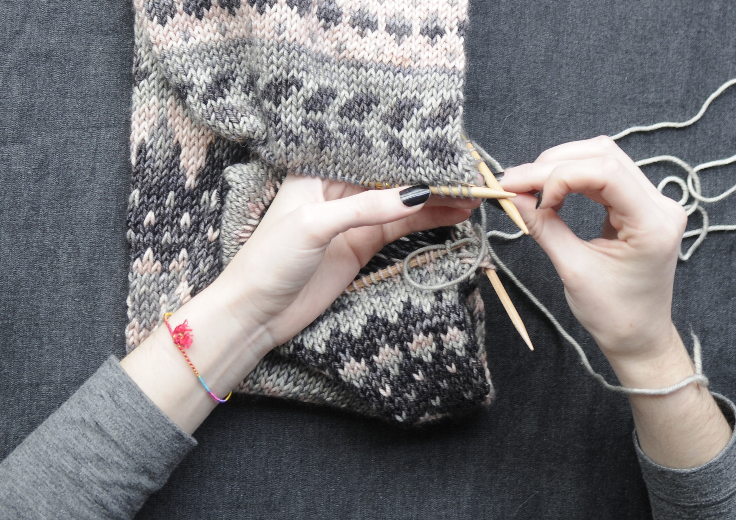 5. Now insert the darning needle as if to knit, into the first stitch on TN. Continue to gently pull your thread snug as you work across the stitches.