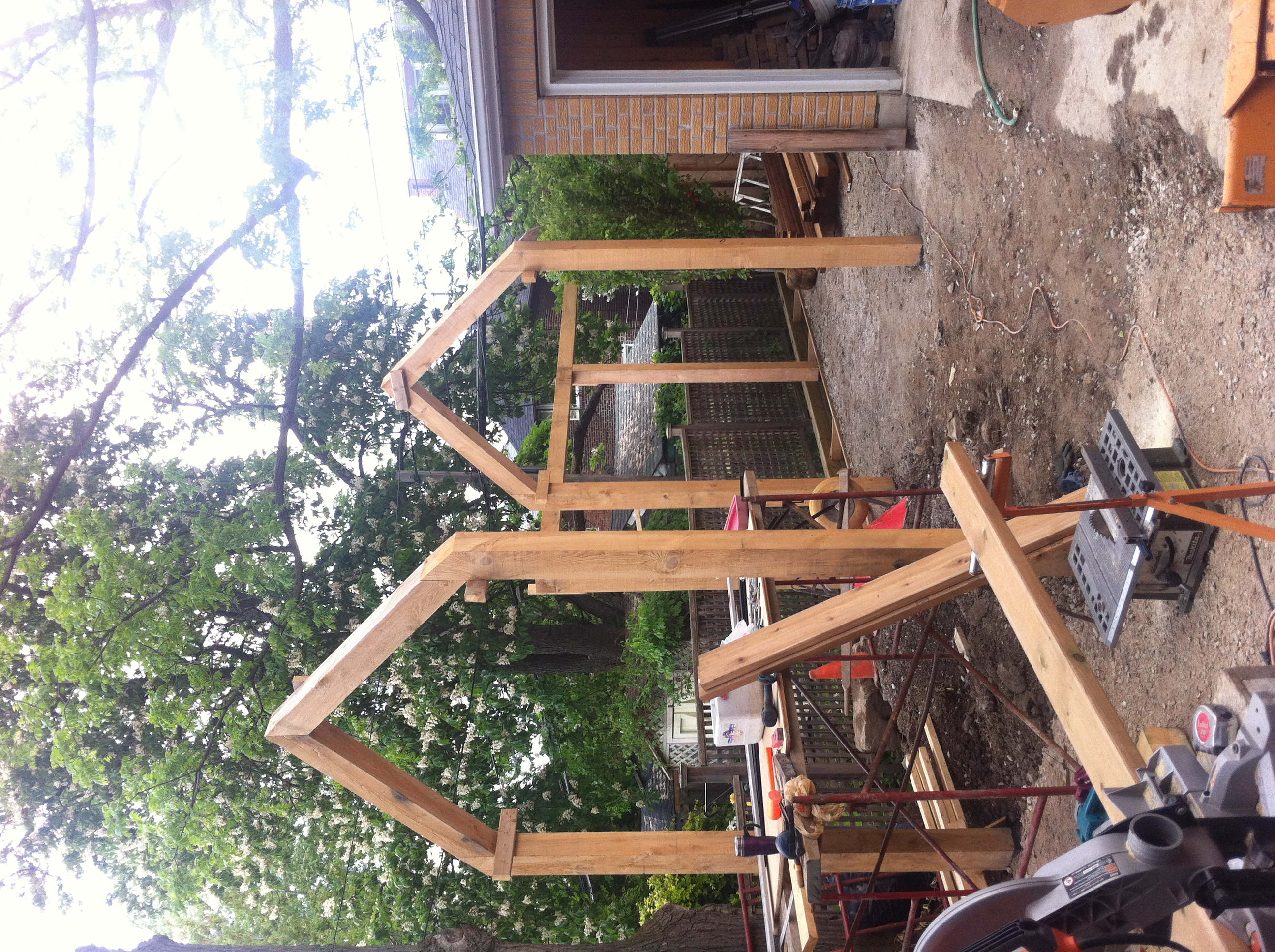 "We used hemlock timbers to create the ""house frame"" archway"