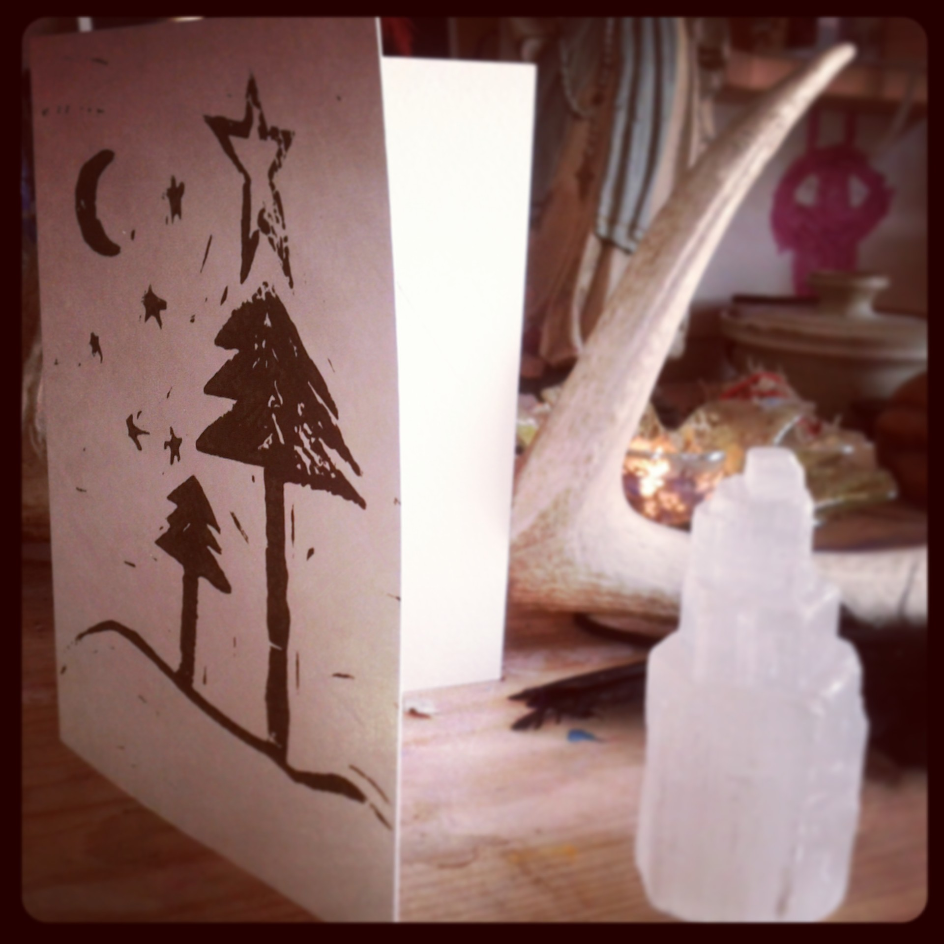a winter solstice wood block print with selenite tower.