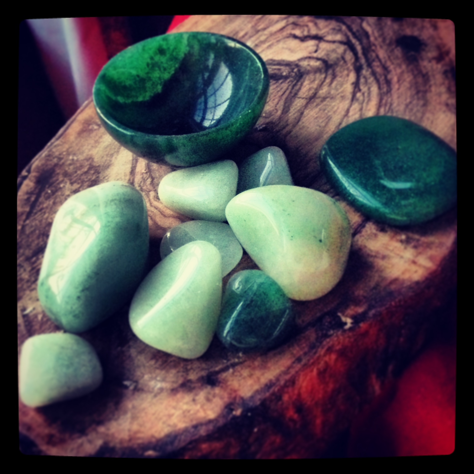 Green Aventurine's tones range from pale green to deep forest green, and these tumblies are great for pockets, mojo bags, and for heart healing work. The larger flat palm stone is one I use in crystal healing sessions for the heart chakra or after psychic surgery. The Green Aventurine bowl in the back is a perfect addition to my altar spaces, and usually holds seasonal herbs, flowers or magickal correspondences.