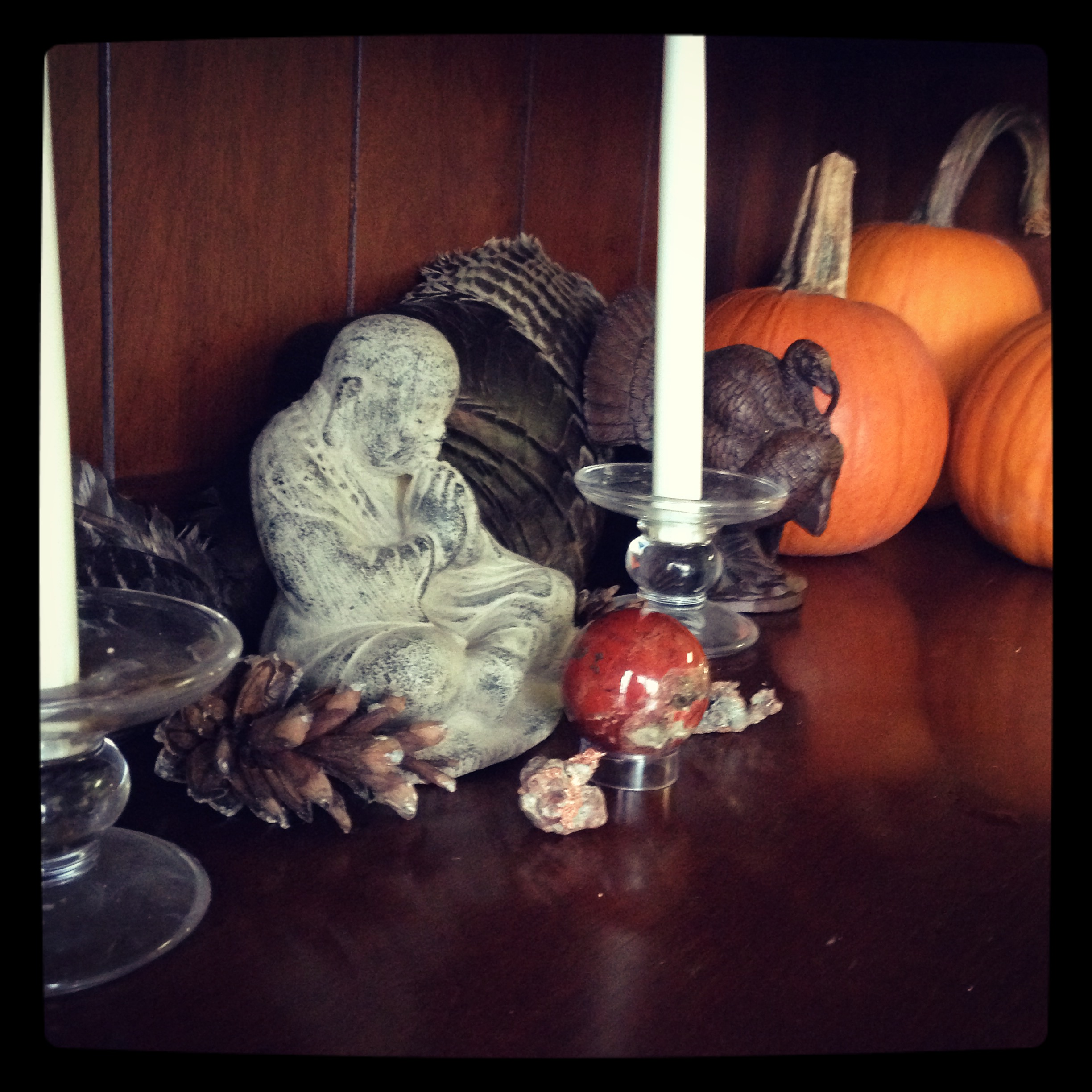 On my side board, I have two turkey wings, a Red Jasper Sphere, Copper and some pine cones and Pumpkins from our yard.