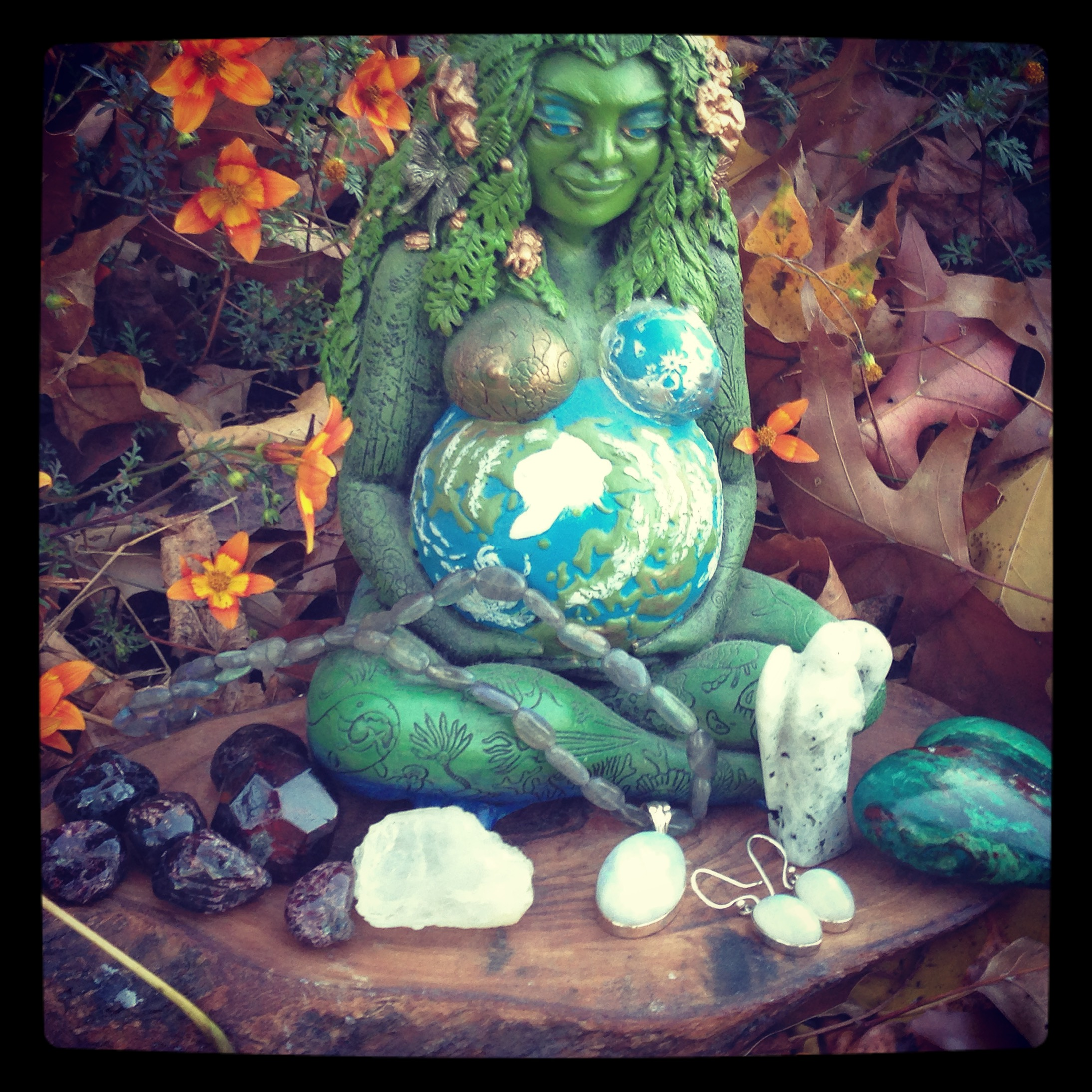 My laboring bag will include from Left to right, Garnet, Petalite, Moonstone pendant on Labradorite and earrings, Moonstone Angel gifted to me from Peter Jarvis of L.A. Crystal Energies, and my Chrysocolla heart sitting in front of my beautiful Gaia statue given to me by my husband.