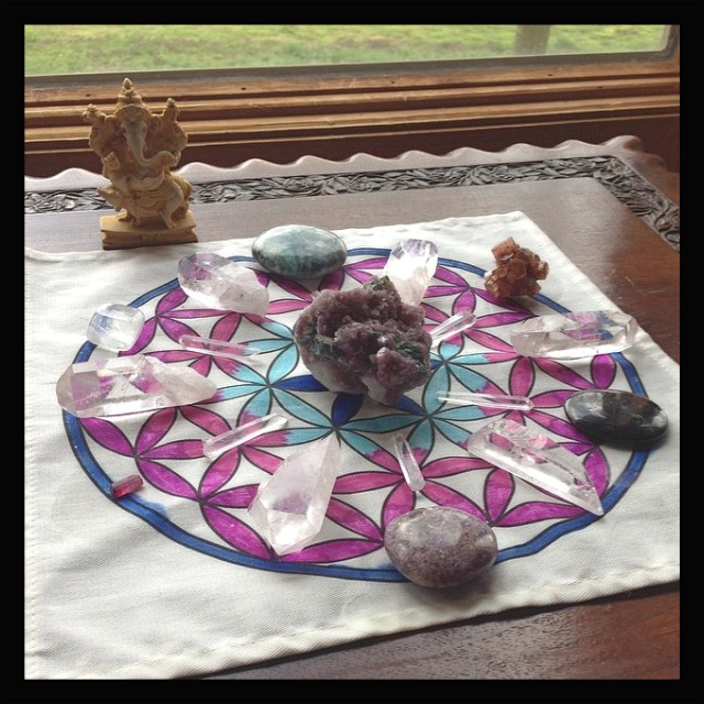 Forgiveness grid centered with lepidolite. Around the edges are lepidolite, rubellite, optical quartz, green kyanite, aragonite, astrophyllite and clear quartz points.