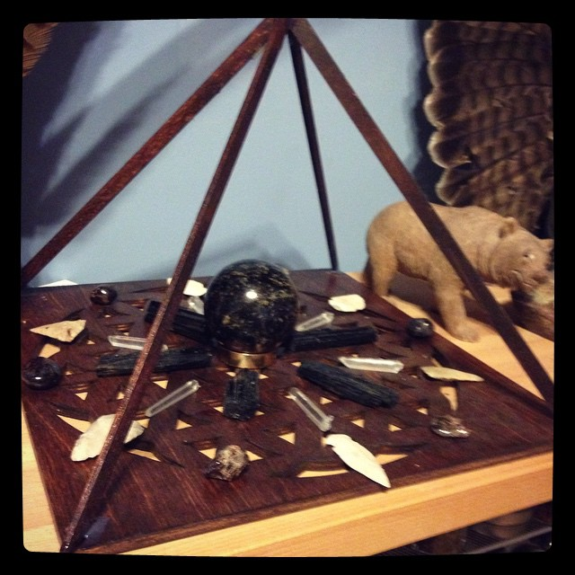 Bear medicine grid with black tourmaline and garnet sphere, garnet, black tourmaline, and white arrowheads