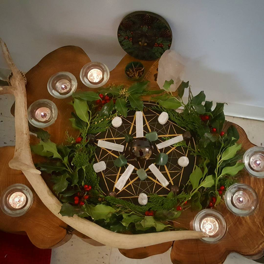Winter Solstice altar with grid, selenite, garnet and green aventurine.