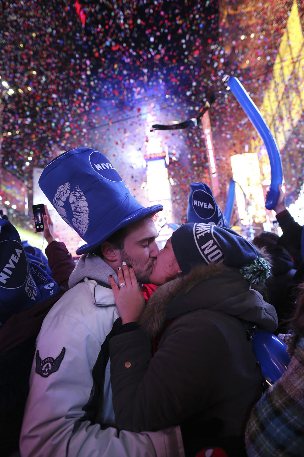 December 31, 2013. New York City, NY. Revelers kiss at midnight in Times Square. Credit: Elizabeth D. Herman for The New York Times