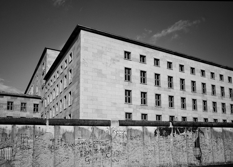 ESCAPE   After a year and a half of planning, East German Heinz Holzapfel and his wife and nine-year-old son made their escape in July 1965 to the West over the Berlin Wall from the roof of the House of Ministries. Considered one of the more daring escape attempts over the Wall, Holzapfel used a device constructed from a hammer, nylon cord and bicycle wheel to slide his family to safety.