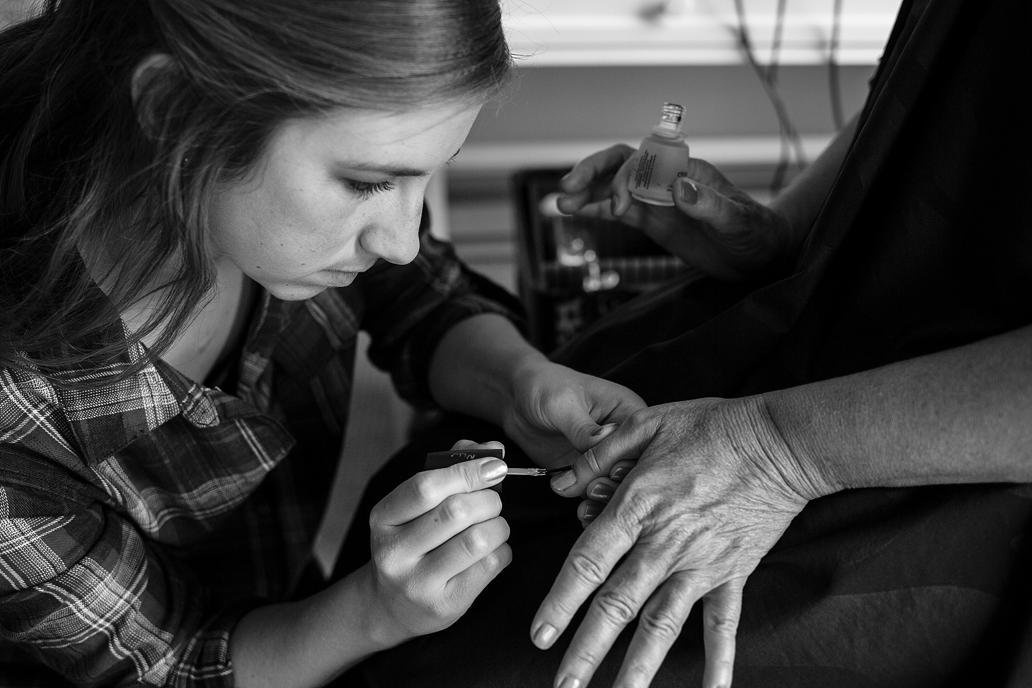 daughter painting mothers nails