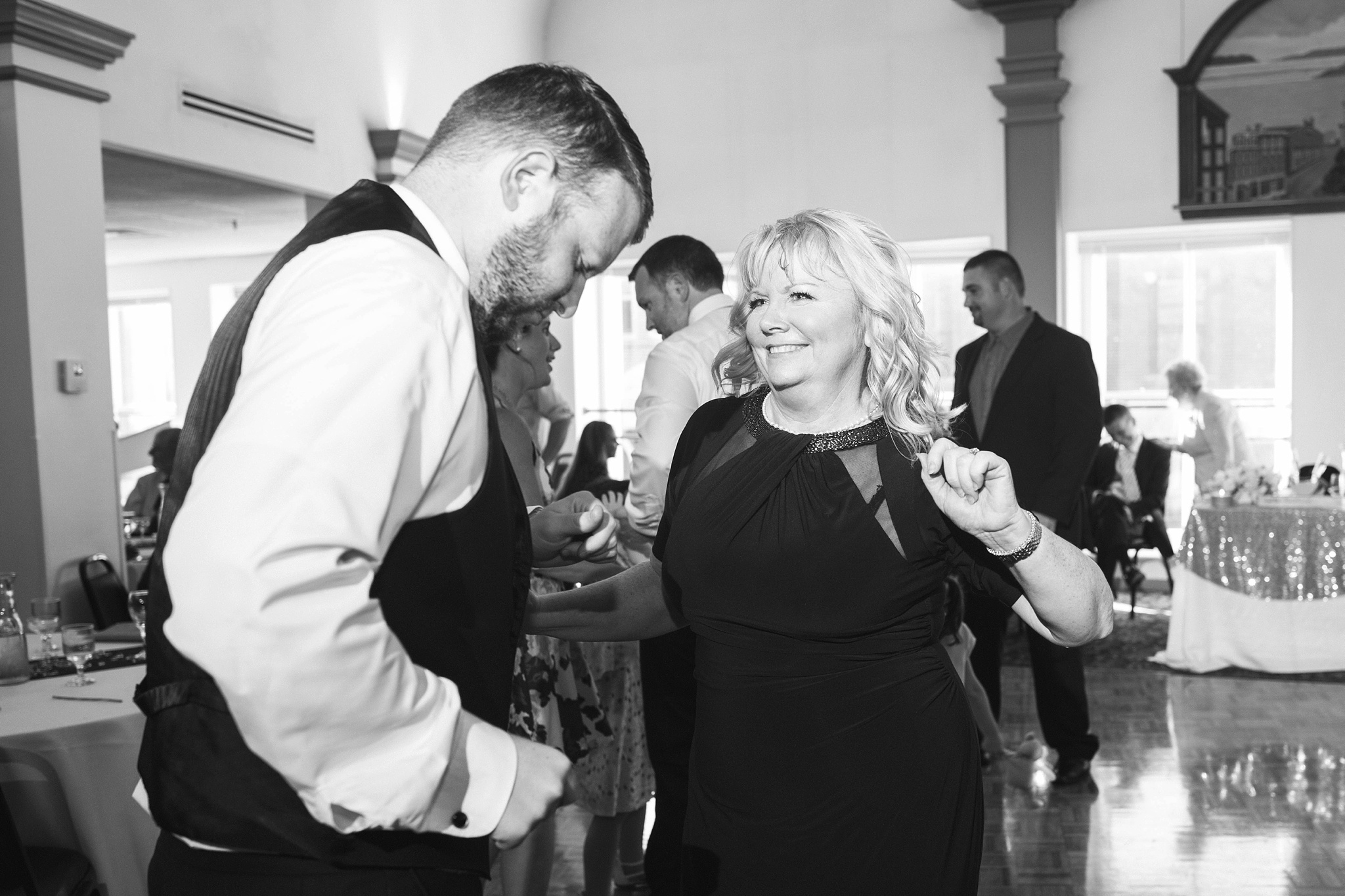 mother and son at wedding