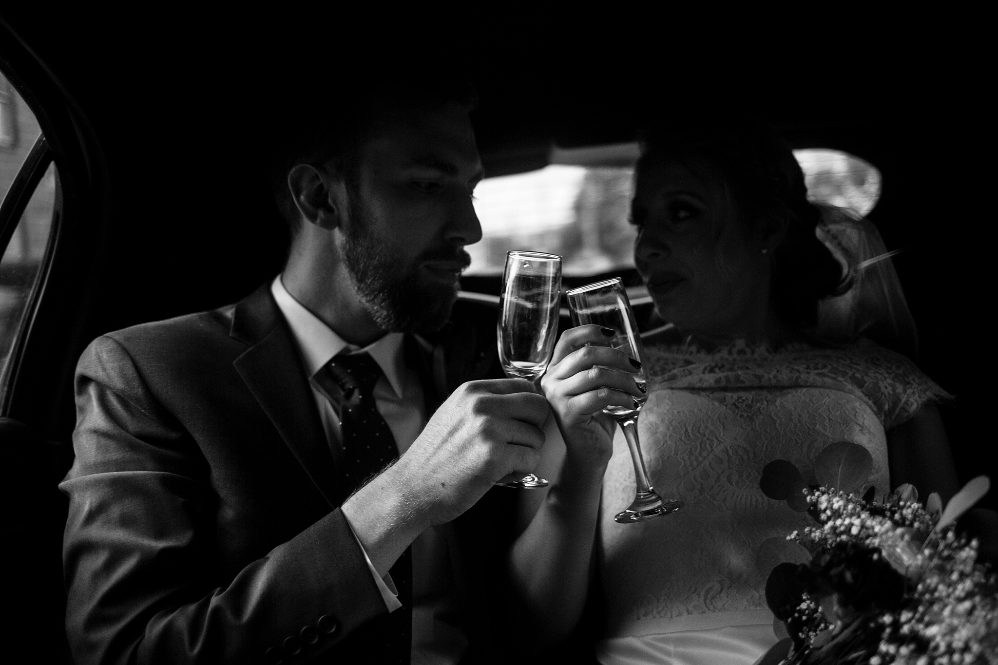 couple-toasting-in-limo