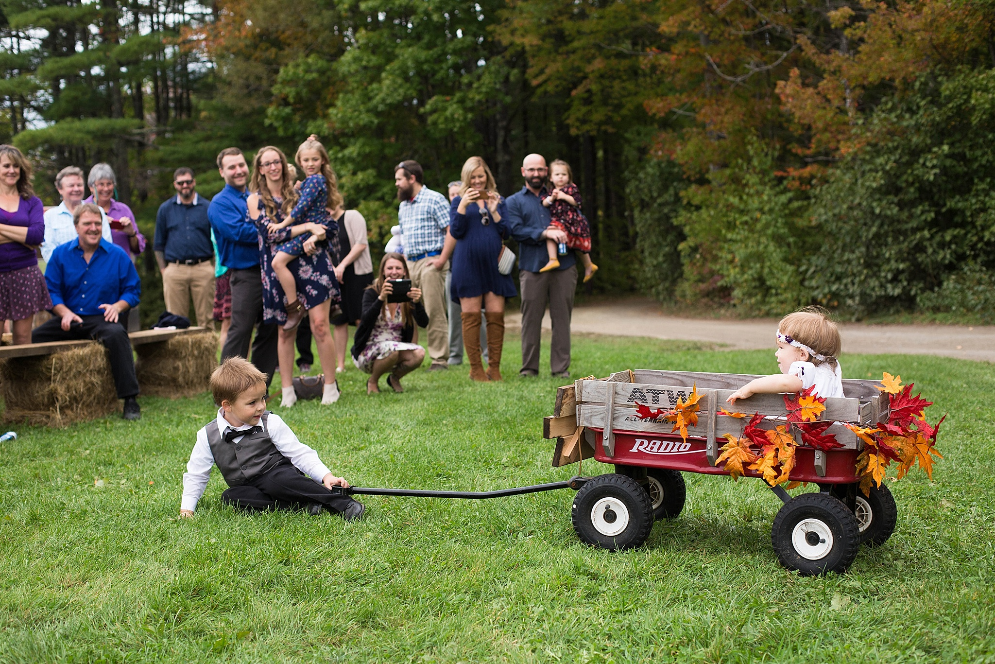 ring bearer pulling flower girl