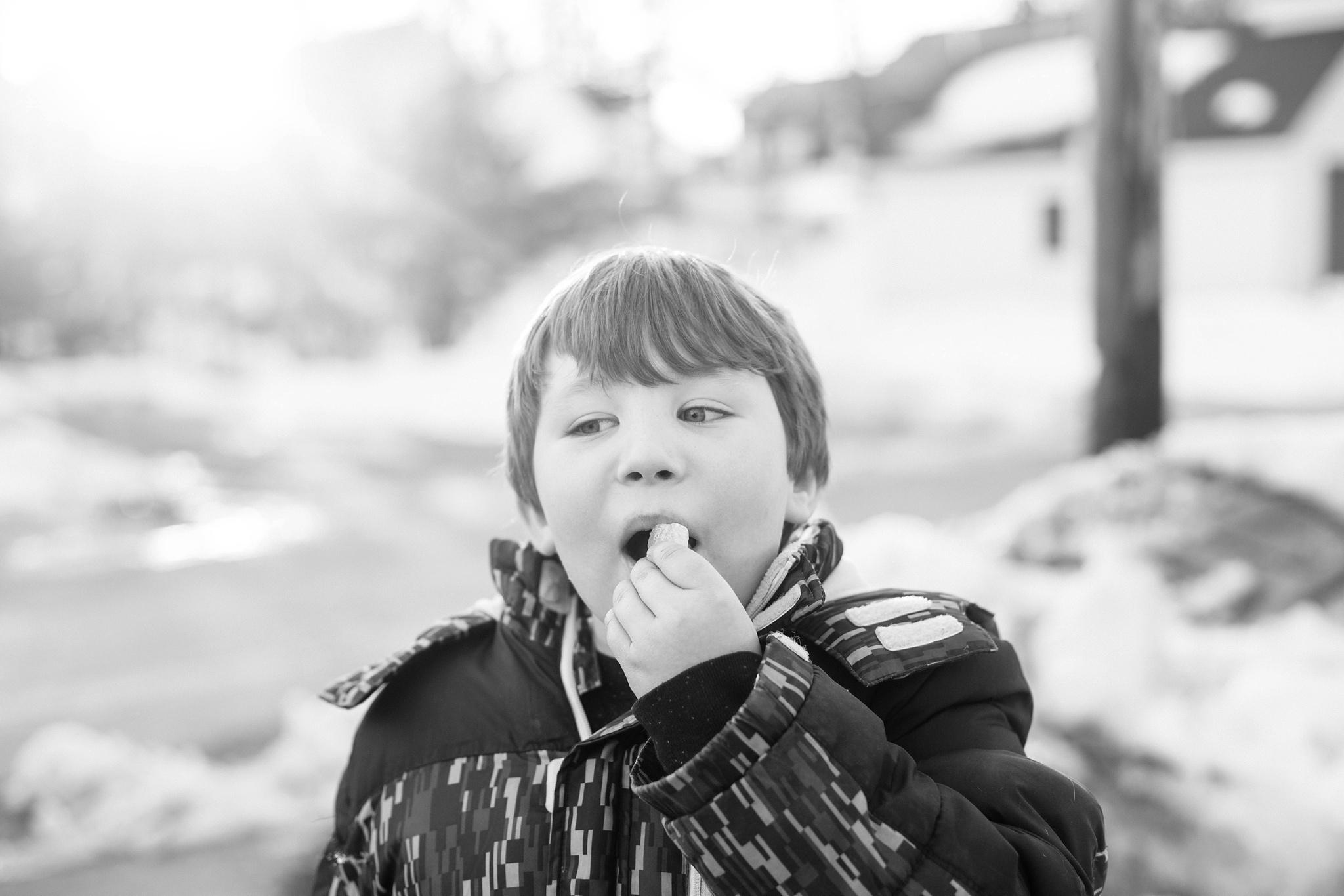 kid eating snow