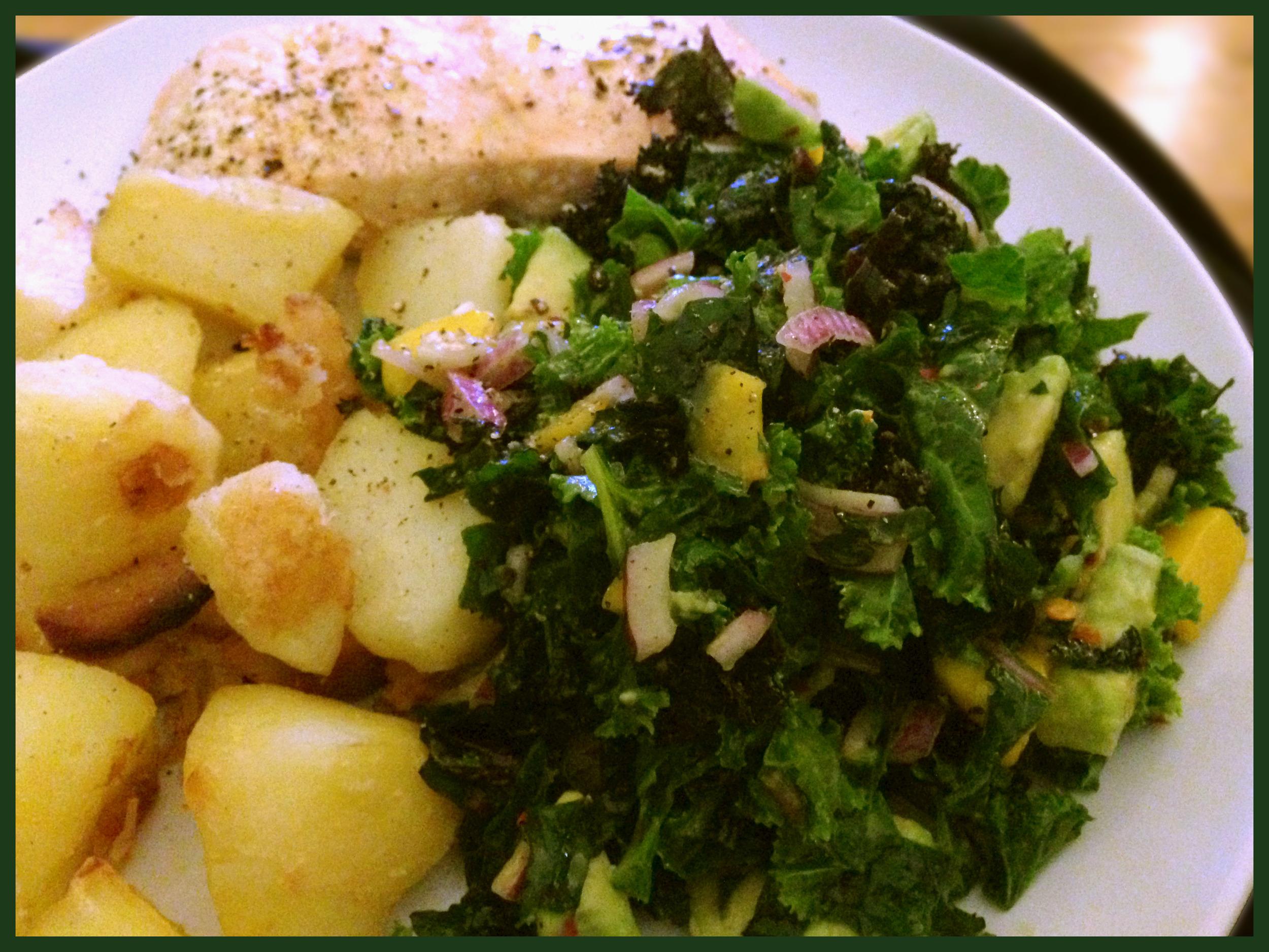 Kale, Avocado and Mango superfood salad with roast potatoes, roast garlic and grilled salmon. Boom!