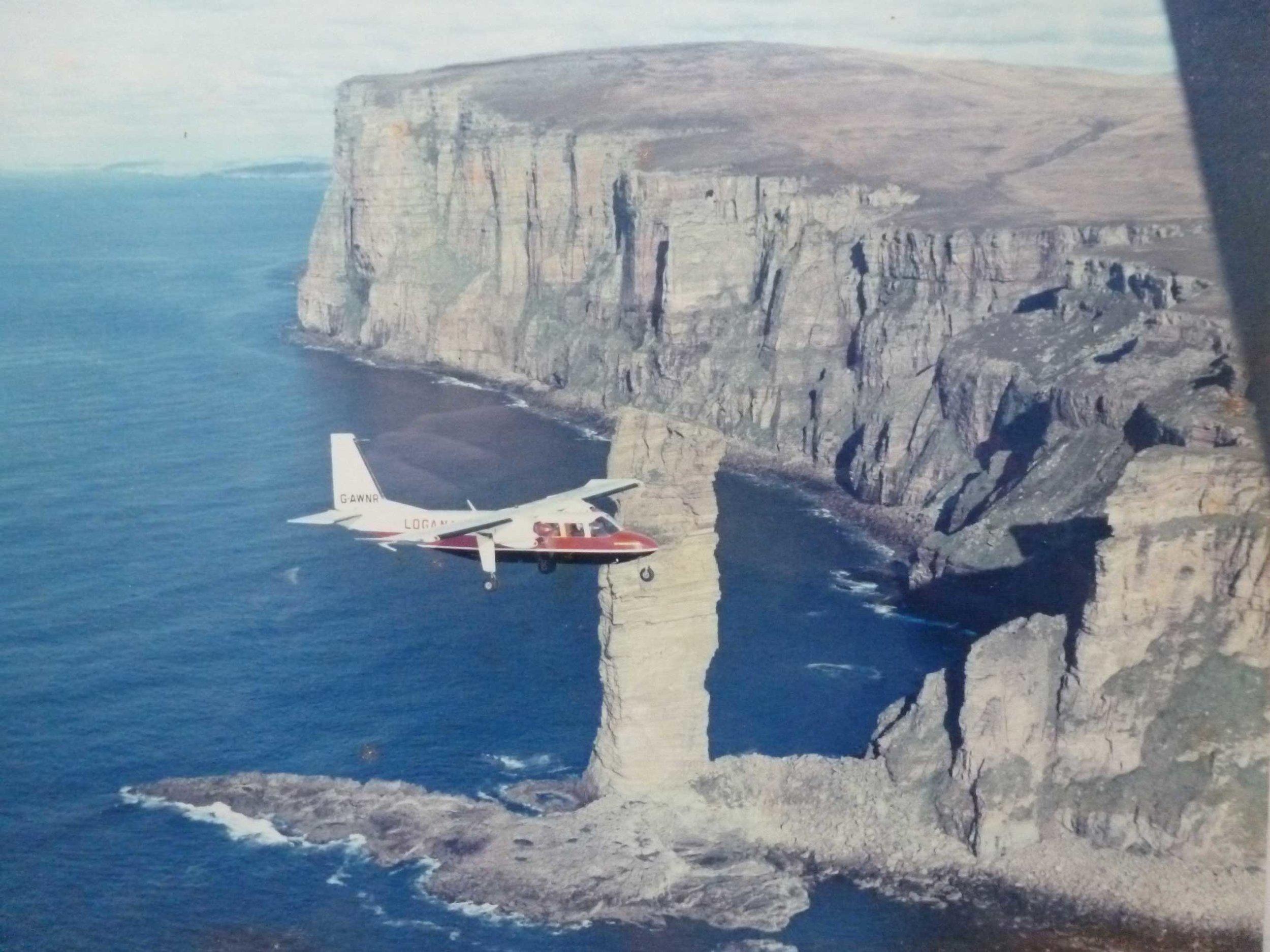 Michael-Parkinson,-Loganair-Islander-at-Old-Man-of-Hoy.jpg