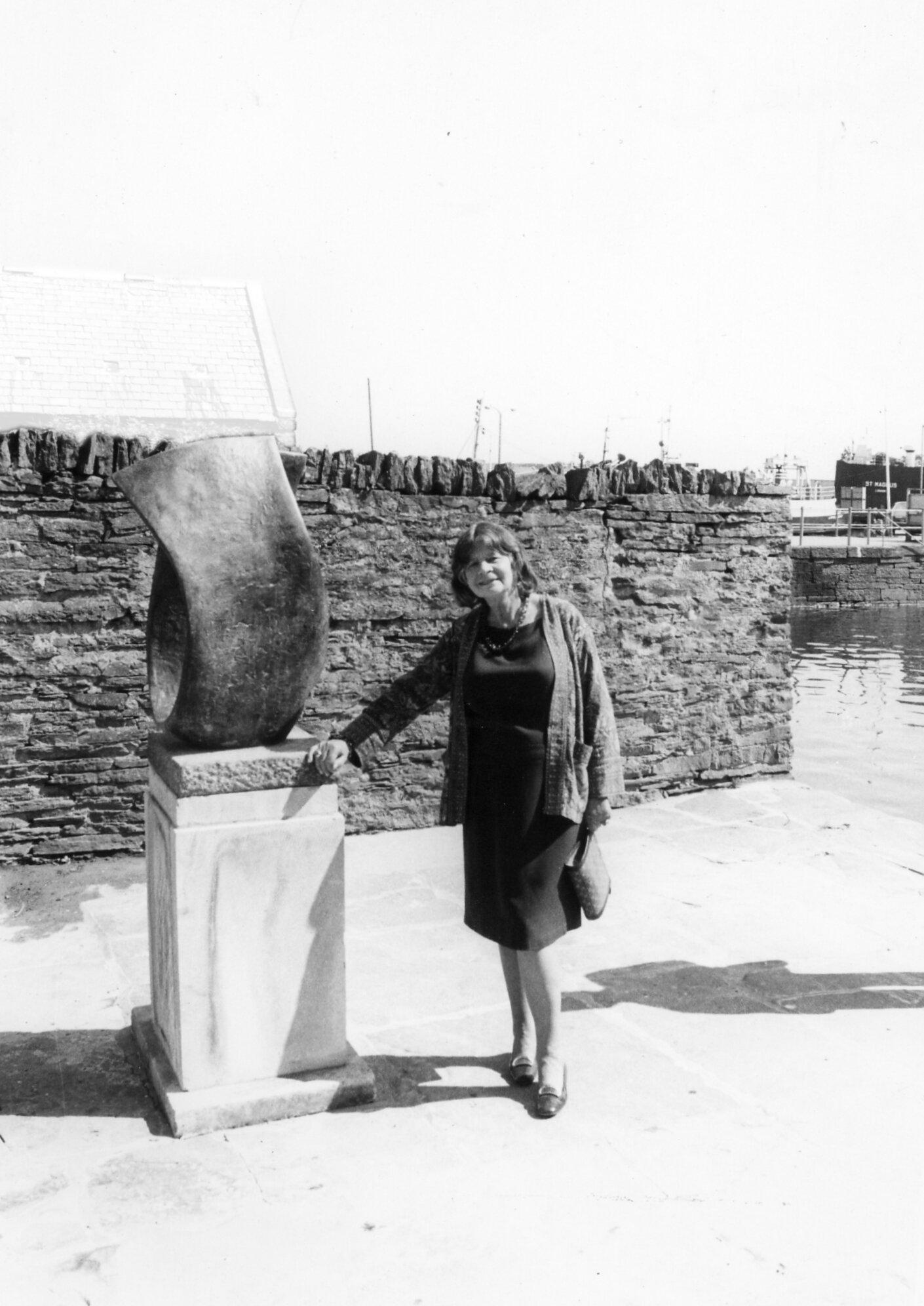 Image: Margaret Gardiner c. 1980 at the Pier Arts Centre  with Barbara Hepworth's sculpture  Curved Form (Trevalgan)  1956