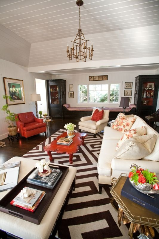 And oversized graphic fretwork pattern rug sets the tone for this eclectic La Jolla living room.