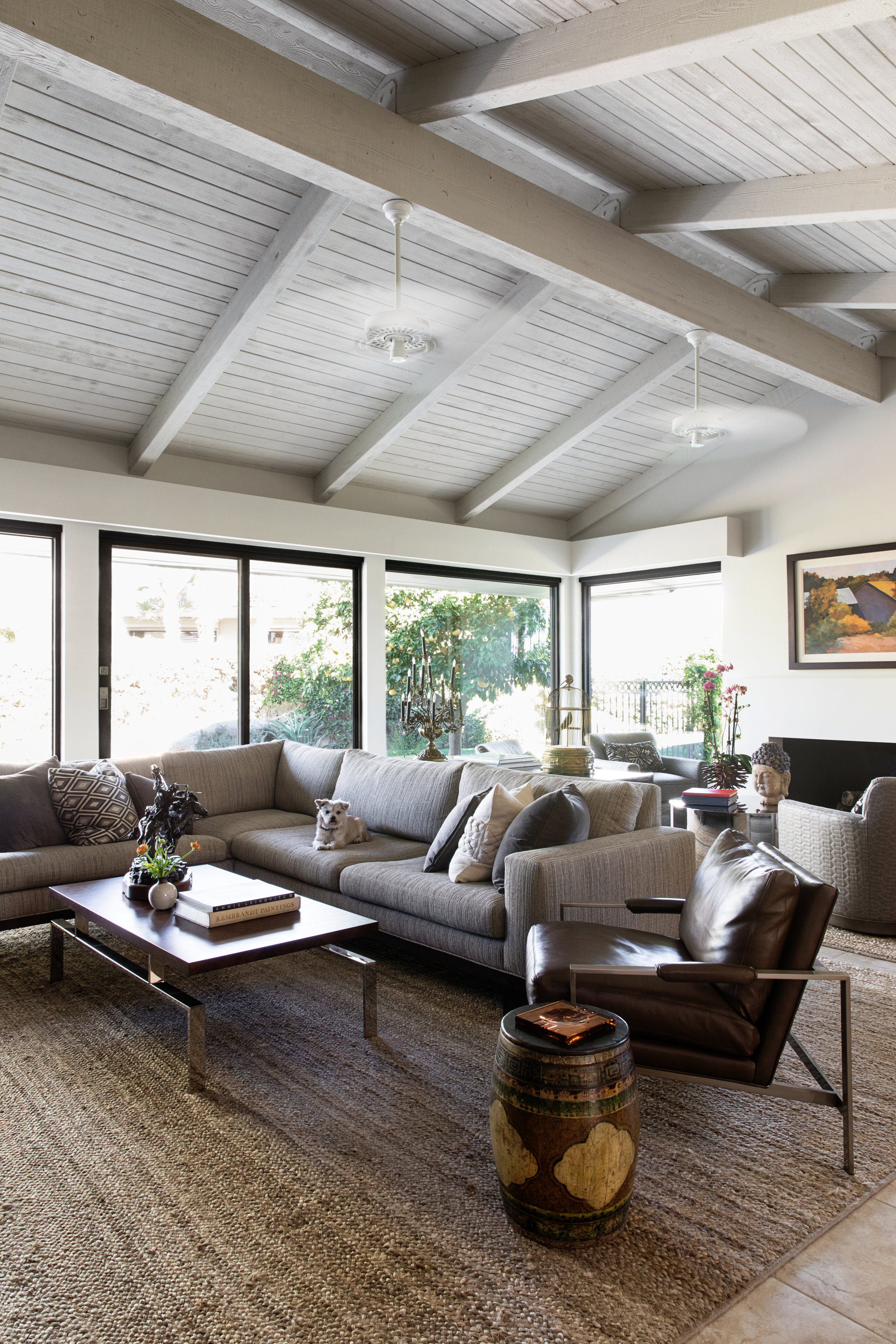 A clean, neutral palette and modern classics by Thayer Coggin create a seamless backdrop for a new life in the California desert.