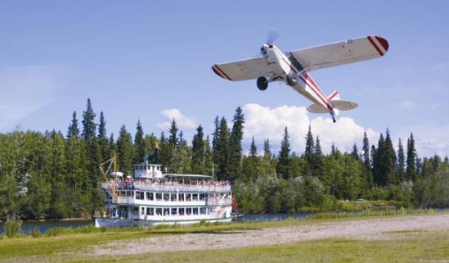 A Bush Pilot taking off near the China River near Fairbanks, Alaska.