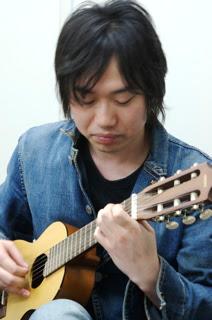 Mitsuru Araya on his mini guitar playing another technical tune.