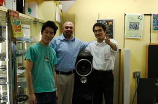 Sato, Adam, and Hiroshi posing with the Maserati Blue Nettuno Druid on display at Audio Union .