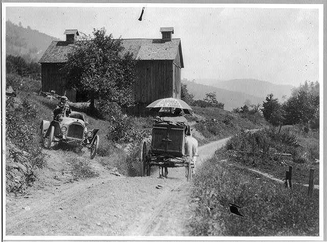 Buick roadster waits for horse-drawn wagon to pass on narrow country road above Liberty, N.Y., circa 1912.  Courtesy of Library of Congress, Prints and Photographs Division