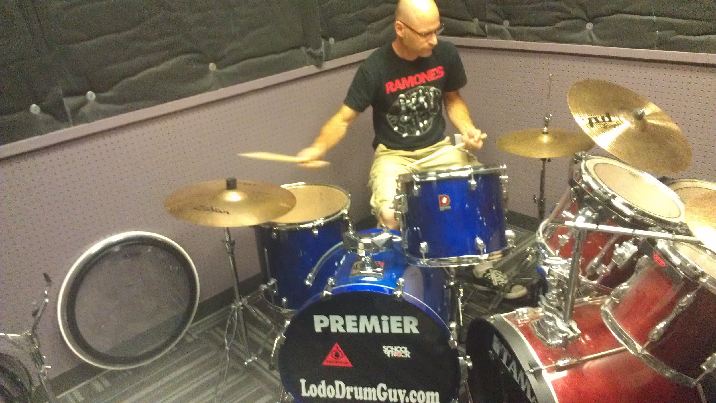 Chris Soucy, Mountain Regional Manager, test driving School of Rock's new house drum kit.