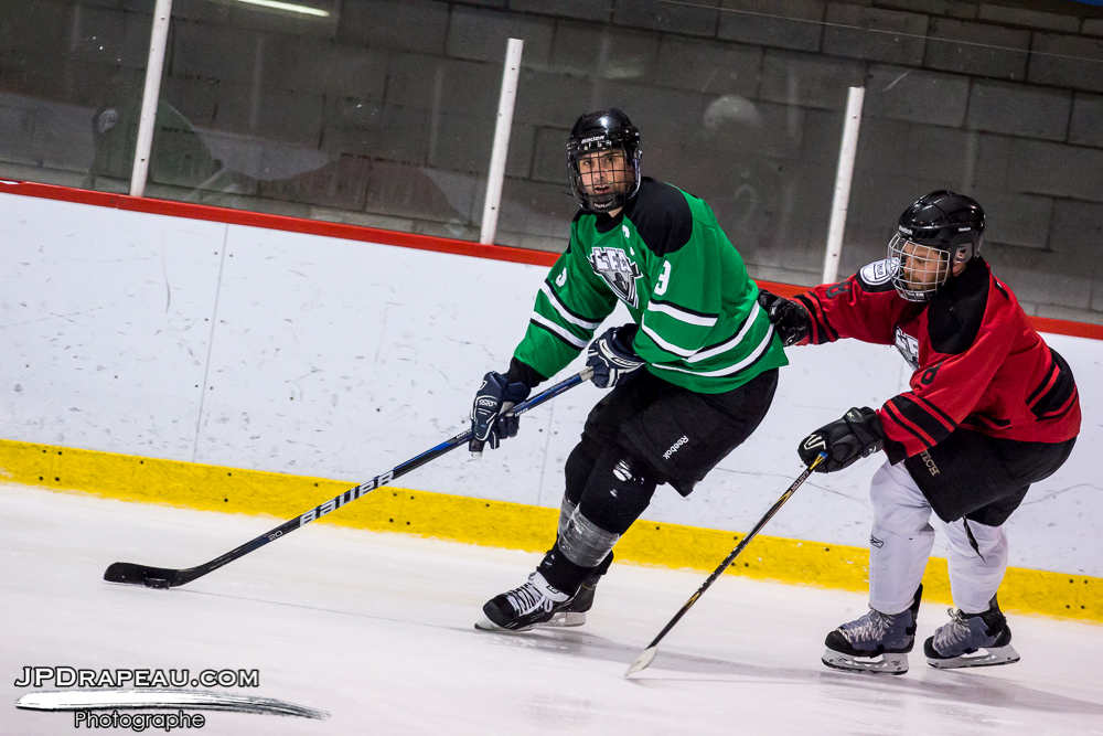Julien Staeger of the Shamrocks doing his stuff against Tom Spencer of the Tomahawks in the closing game of the night
