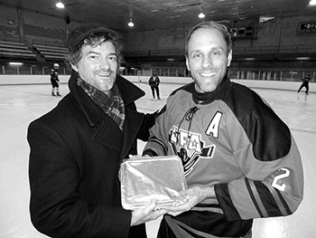 MARTY DESJARDINS THE 1ST EVER WINNER OF THE PLAYER OF THE MONTH AWARD, RECEIVING A HOME MADE SHEPARD PIE FROM THE PRESIDENT OF THE LFA LAST FALL