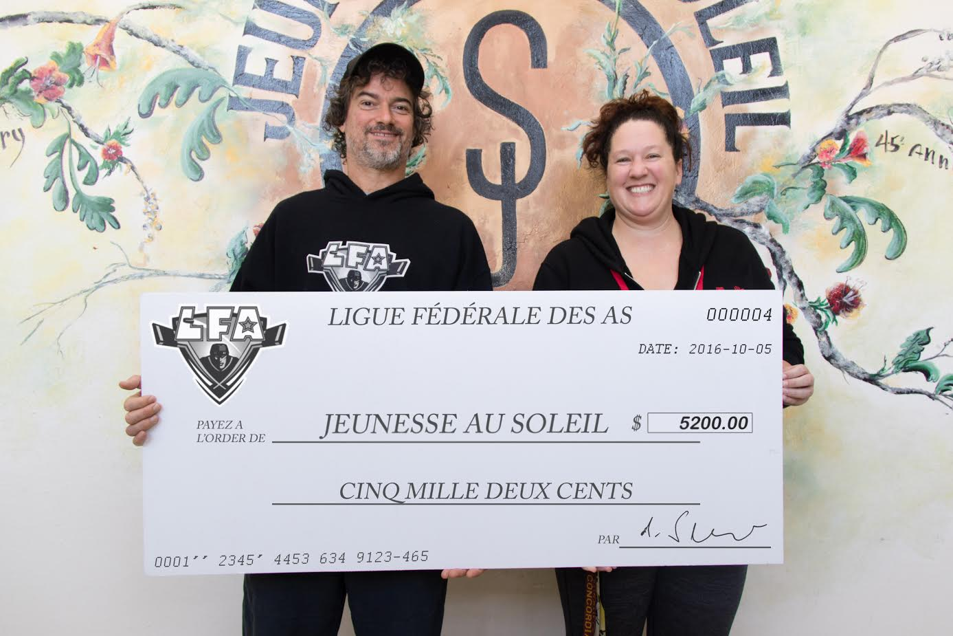 Jean-François DesBois, the LFA's CEO, proudly presented a check of 5200$ to Kara De La Peralle from Sun Youth. The money raised during last summer Championship game will help to finance the fondation's SLAP hockey development program and thus make a positive impact on lives of several young players in the Montreal region.