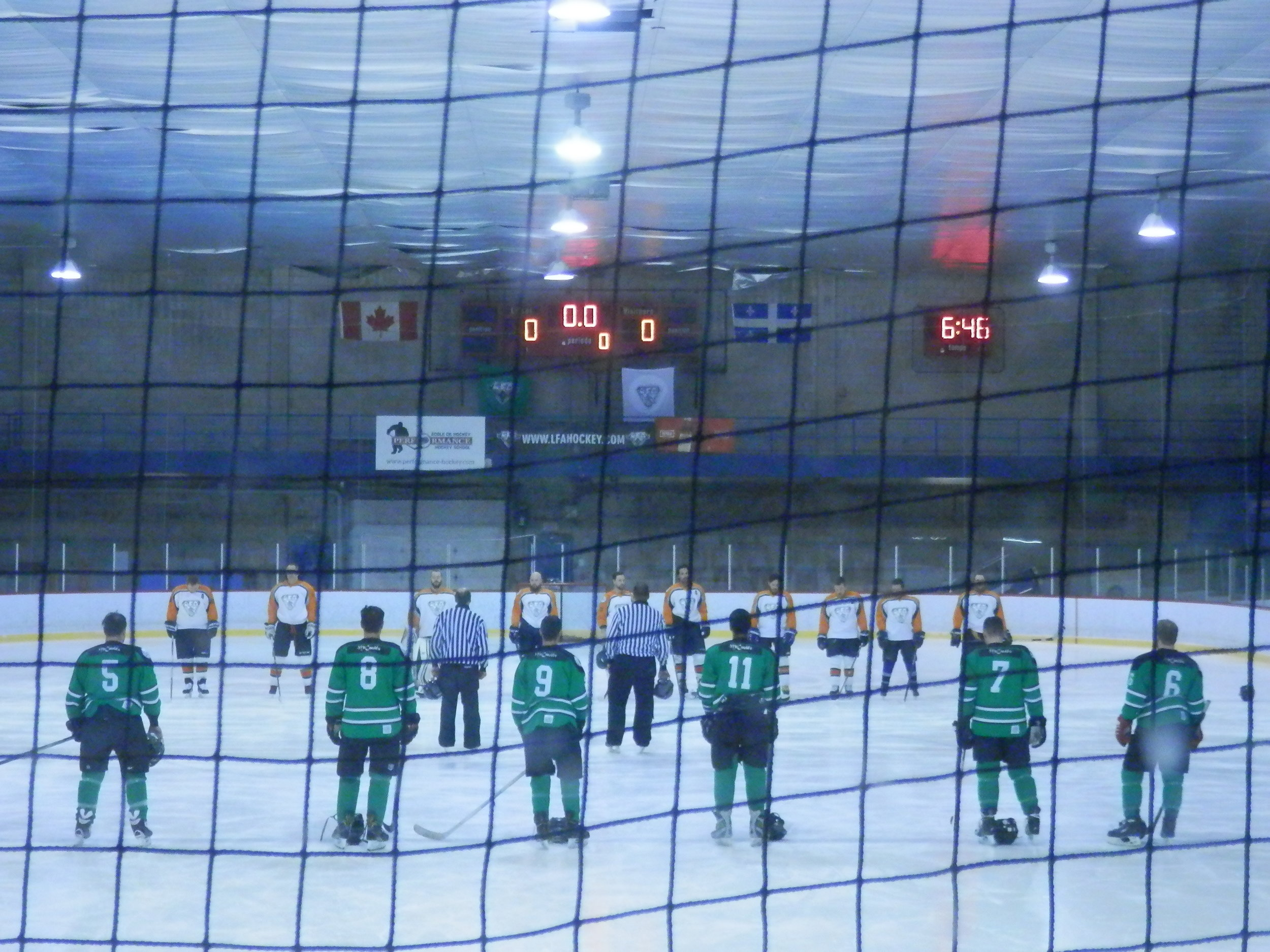 Players and officials removed their helmets prior to each game in honor of the Humboldt Broncos members who lost their lives in early April (photo jfd)