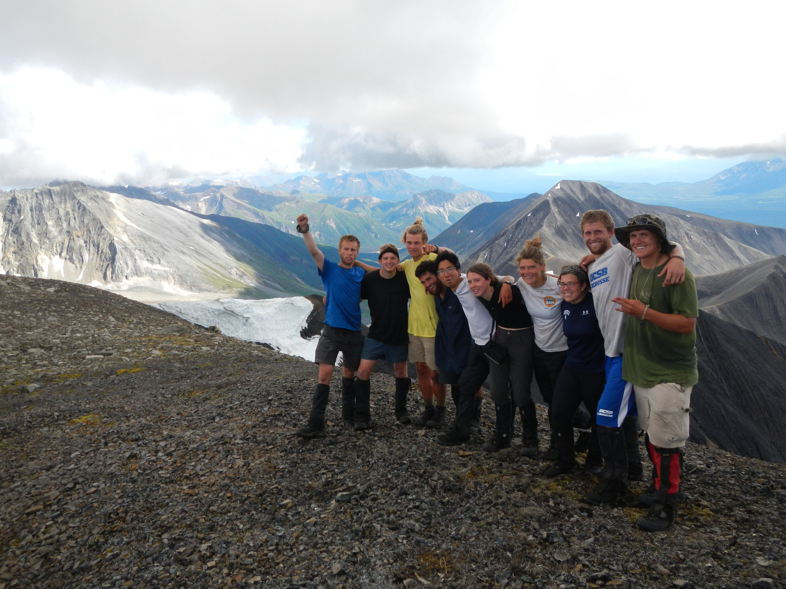 Students at the top of a ridge line while backpacking