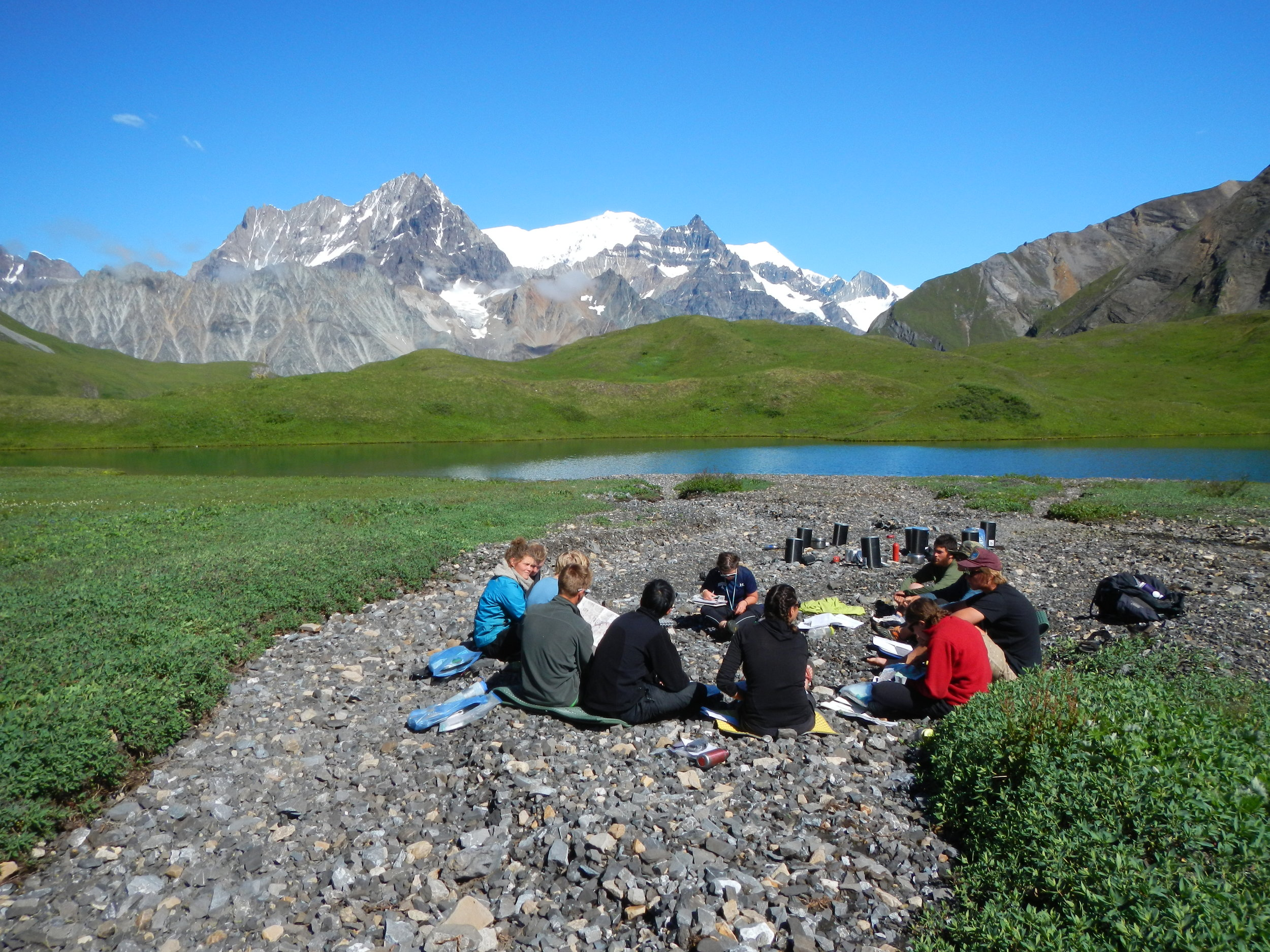 A discussion group in the back-country of Wrangell-St. Elias National Park