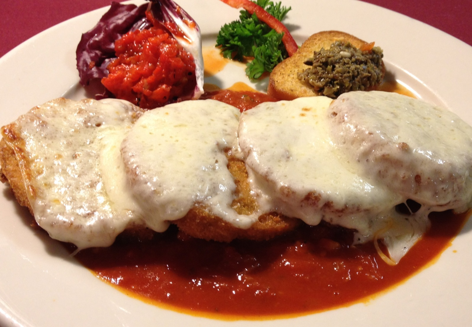 Breaded and Fried Eggplant Rounds with Mozzarella Cheese and Marinara Sauce