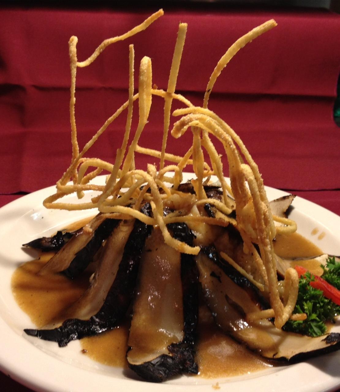 Grilled Portobello Mushroom Sliced over Whipped Potatoes…Marsala Wine  Sauce