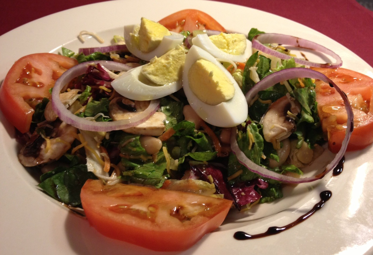 Quiet Man Tossed Salad...Mixed Greens, Hard-Cooked Egg,  Pickled Beets, Tomatoes, Mushrooms, Thin Red Onions, Raw Carrots served with Vinaigrette Dressing