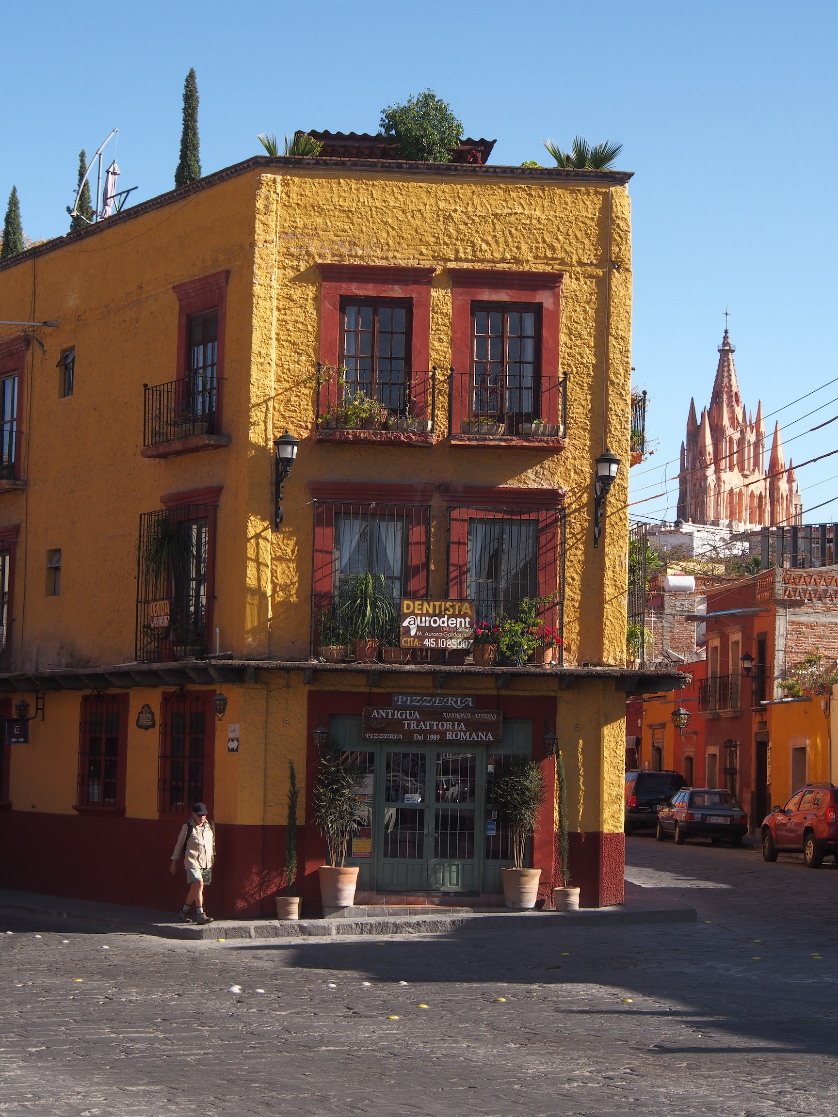 Colourful street corner with Parroquia in background