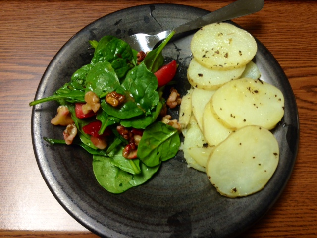 Spinach-strawberry-walnut salad with baked russet potatoes, tossed in olive oil, seat salt and pepper